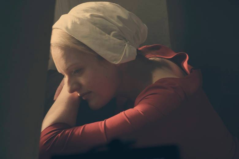 """The Handmaid's Tale  -- """"Nigh"""" -- Episode 110 -- Serena Joy confronts Offred and the Commander. Offred struggles with a complicated, life-changing revelation. The Handmaids face a brutal decision. Offred (Elisabeth Moss), shown. (Photo by: George Kraychyk/Hulu)"""
