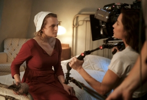 """The Handmaid's Tale  -- """"Late"""" Episode 103 --  Offred visits JanineÕs baby with Serena Joy and remembers the early days of the revolution before Gilead. Ofglen faces a difficult challenge. Behind the scenes with Offred (Elisabeth Moss) and Reed Morano, shown. (Photo by: George Kraychyk/Hulu)"""