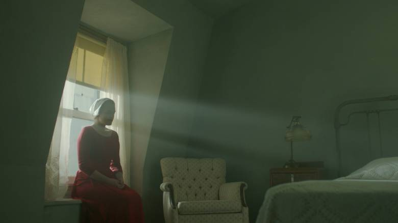 "THE HANDMAID'S TALE -- ""Offred"" - Episode 101 - Offred, one the few fertile women known as Handmaids in the oppressive Republic of Gilead, struggles to survive as a reproductive surrogate for a powerful Commander and his resentful wife. Offered (Elisabeth Moss), shown. (Photo by: Take Five/Hulu)"