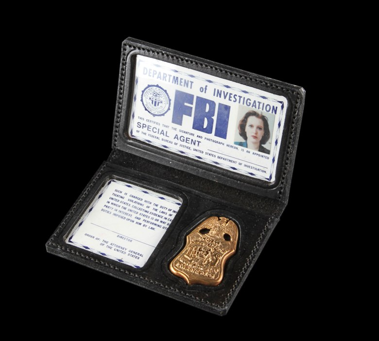 MANDATORY CREDIT: Prop Store/Rex Shutterstock. Only for use in this story. Editorial Use Only. No stock, books, advertising or merchandising without photographer's permissionMandatory Credit: Photo by Prop Store/REX/Shutterstock (6030207x)Scully (Gillian Anderson) FBI Photo ID & Badge from The X-Files (1993-2002) sold for £7,200Prop Store film and TV memorabilia auction, London, UK - 27 Sep 2016FULL COPY: http://www.rexfeatures.com/nanolink/srmfProp Store ? one of the world?s leading film and TV memorabilia companies ? has today announced the news from yesterday?s largest live auction of film and TV memorabilia in the UK, with items on offer fetching in excess of £1.5 million. The Prop Store live auction, run in partnership with ODEON ? Europe?s largest cinema chain ? was held yesterday (Tuesday 27 September) at London?s BFI IMAX proudly presented by ODEON.Collectors from around the world gathered yesterday at the Prop Store?s unique Entertainment Memorabilia Live Auction, which achieved unprecedented results over ten hours of exciting and intensive bidding.One of the top results of the day was the TIE Pilot Helmet from Star Wars: A New Hope (1977) which achieved a world record breaking sale price for a Star Wars helmet of £210,00 ($273,423).