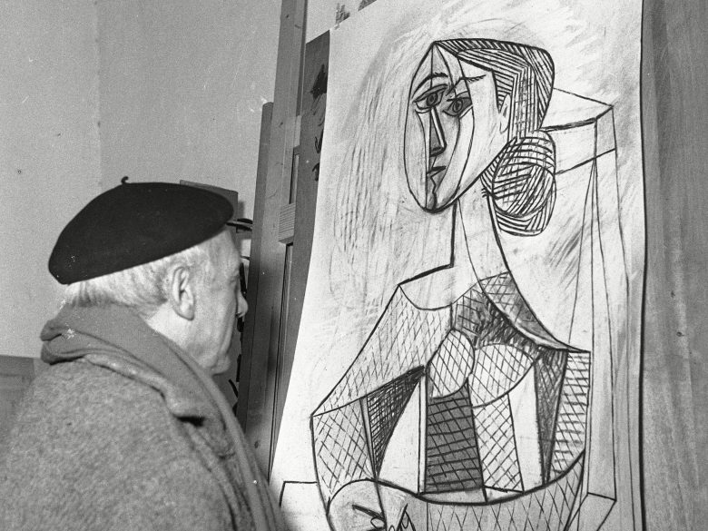 "Artist Pablo Picasso looks at a recent painting, ""Portrait of a Woman,"" in his studio in Vallauris, French RivieraPicasso 1953, Vallauris, France"