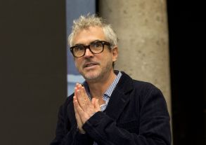 """Mexican director Alfonso Cuaron gestures toward journalists as he arrives for a press conference following the end of filming of his new movie """"Roma,"""" in Mexico City, . """"Roma,"""" a family drama set in the 1970s, marks the first time the Oscar-winning director has filmed in his home country since 2001's """"Y tu mama tambienAlfonso Cuaron, Mexico City, Mexico - 14 Mar 2017"""