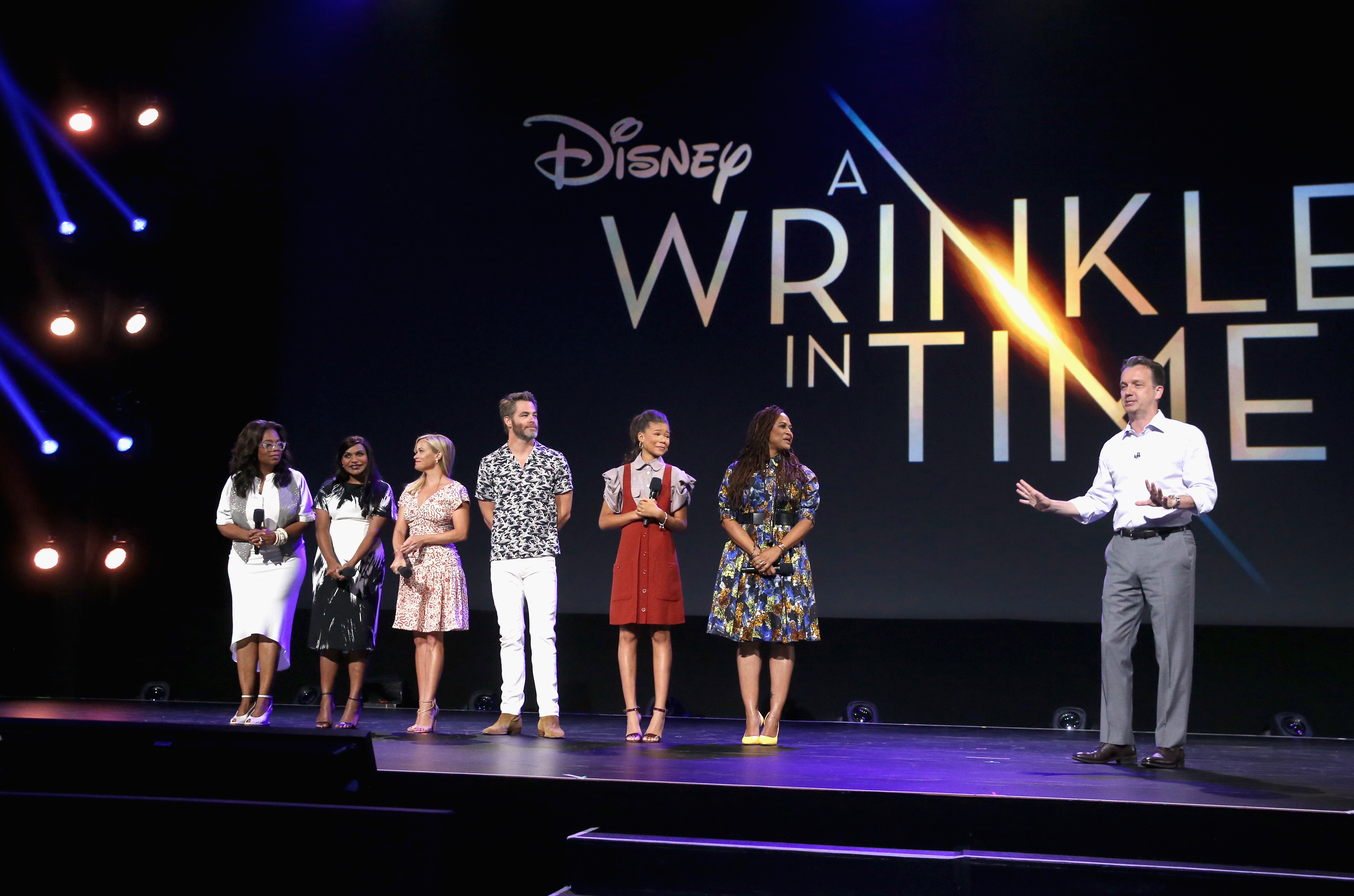 ANAHEIM, CA - JULY 15: (L-R) Actors Oprah Winfrey, Mindy Kaling, Reese Witherspoon, Chris Pine, Storm Reid of A WRINKLE IN TIME, director Ava DuVernay of A WRINKLE IN TIME, and President of Walt Disney Studios Motion Picture Production Sean Bailey took part today in the Walt Disney Studios live action presentation at Disney's D23 EXPO 2017 in Anaheim, Calif. A WRINKLE IN TIME will be released in U.S. theaters on March 9, 2018. (Photo by Jesse Grant/Getty Images for Disney) *** Local Caption *** Reese Witherspoon; Oprah Winfrey; Mindy Kaling; Chris Pine; Storm Reid; Ava DuVernay; Sean Bailey