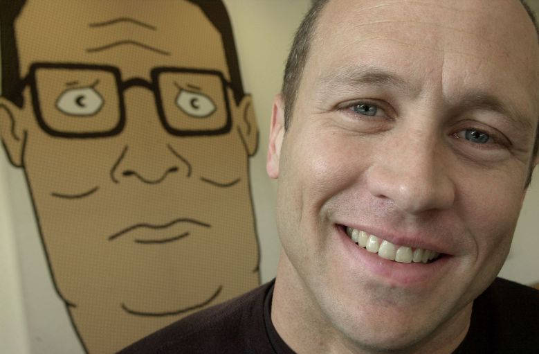 """Mike Judge Mike Judge, co-creator of the Fox cartoon series """"King of the Hill,"""" poses in front of an illustration of the animated character he voices, Hank Hill, in Los Angeles. After toiling for years in obscure time slots, the working-class comedy returns to prime-time on Sunday, Nov. 3TV KING OF HILL, LOS ANGELES, USA"""