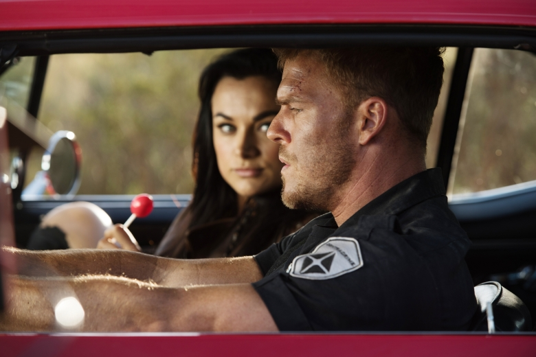 "BLOOD DRIVE -- ""A Fistful of Blood"" Episode 108 -- Pictured: (l-r) Christina Ochoa as Grace, Alan Ritchson as Arthur -- (Photo by: David Bloomer/Syfy)"