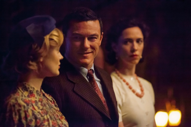 Bella Heathcote stars as Olive Byrne, Luke Evans as Dr. William Marston and Rebecca Hall as Elizabeth Marston in PROFESSOR MARSTON AND THE WONDER WOMEN, an Annapurna Pictures release.Credit: Claire Folger / Annapurna Pictures