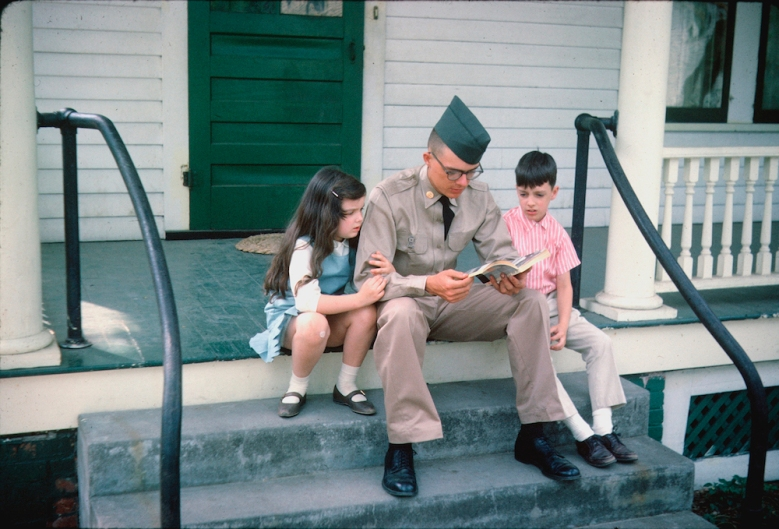 Denton (Mogie) in uniform, sitting on porch steps with Candy and Randy 1965.