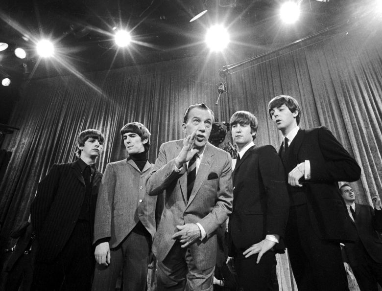 "Ringo Starr, George Harrison, Ed Sullivan John Lennon, Paul McCartney Ed Sullivan, center, stands with The Beatles, from left, Ringo Starr, George Harrison, John Lennon and Paul McCartney, during a rehearsal for the British group's first American appearance on ""The Ed Sullivan Show,"" in New York. A small, 18-inch solid bronze statue of the legendary television variety show host, Sullivan, has been recovered by Los Angeles police . The statue was taken Sunday from atop a pedestal in an outdoor exhibit at the Academy of Television Arts & Sciences Hall of Fame Plaza in North Hollywood Ed Sullivan Statue, New York, USA"