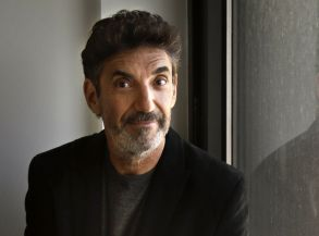 "This photo shows Chuck Lorre, executive producer of the hit sitcoms ""Two and a Half Men,"" ""The Big Bang Theory"" and ""Mike & Molly,"" posing before an interview in New York. Lorre is the author of a coffee table book, ""What Doesn't Kill Us Makes Us Bitter"", a collection of 333 vanity-cards of Lorre's stories and witticisms. Proceeds from the book will benefit Lorre's Dharma-Grace FoundationTV-Chuck Lorres Book, New York, USA"
