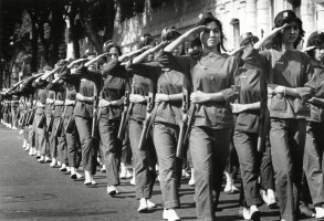 Armed with U.S. rifles, women paramilitary volunteers salute as they march past Vietnam's first lady Madame Ngo Dinh Nhu during a military school graduation in Saigon, . South Vietnam had about 3,000 trained women at the time, with about 1,000 active in the country's military or social serviceVietnam War South Vietnam Women, Saigon, Vietnam