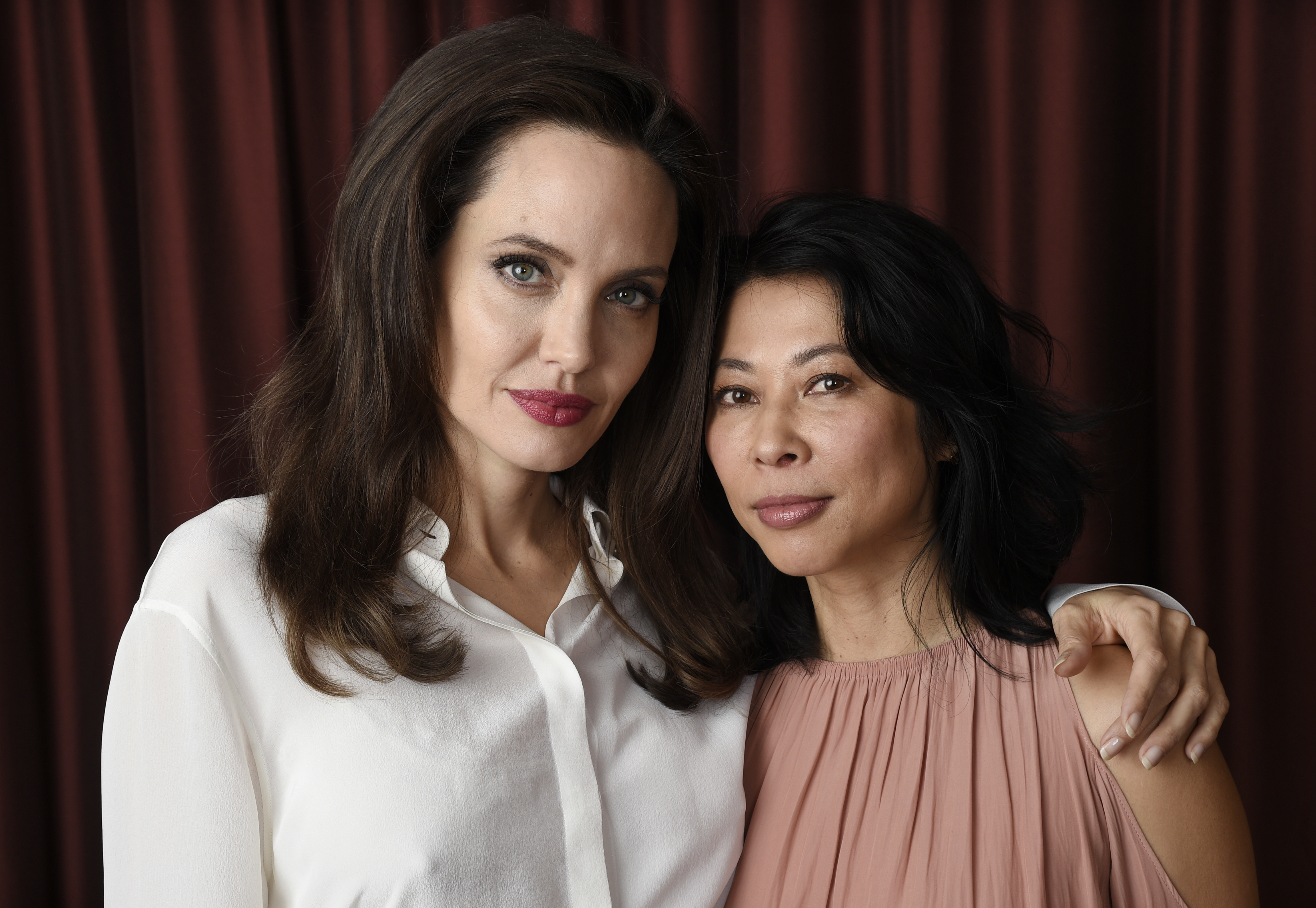 "Angelina Jolie, Loung Ung. Angelina Jolie, left, director/co-writer of the film ""First They Killed My Father: A Daughter of Cambodia Remembers,"" and co-writer/human rights activist Loung Ung pose for a portrait during the Toronto International Film Festival in Toronto2017 TIFF - ""First They Killed My Father"" Portrait Session, Toronto, Canada - 11 Sep 2017"