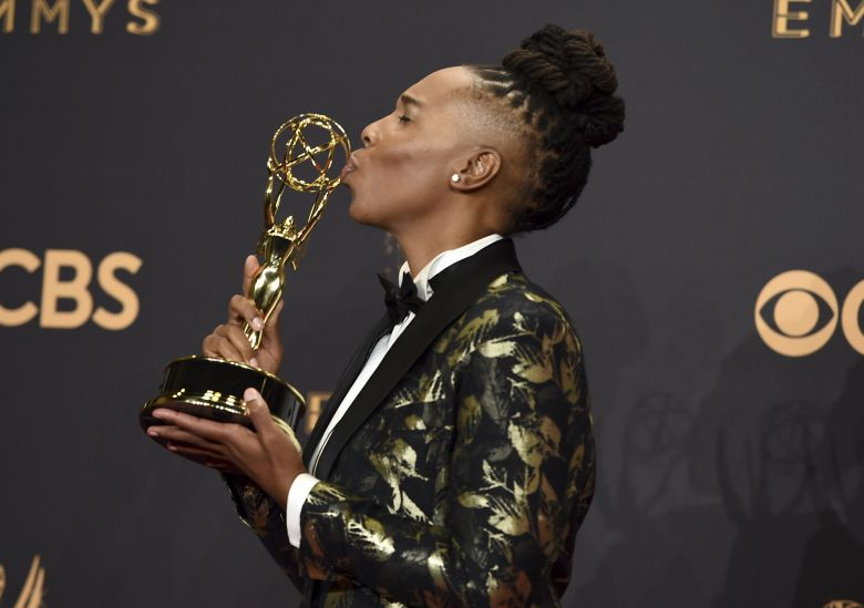 "Lena Waithe poses in the press room with the award for outstanding writing for a comedy series for the ""Master of None"" episode ""Thanksgiving"" at the 69th Primetime Emmy Awards, at the Microsoft Theater in Los Angeles 2017 Primetime Emmy Awards - Press Room, Los Angeles, USA - 17 Sep 2017"