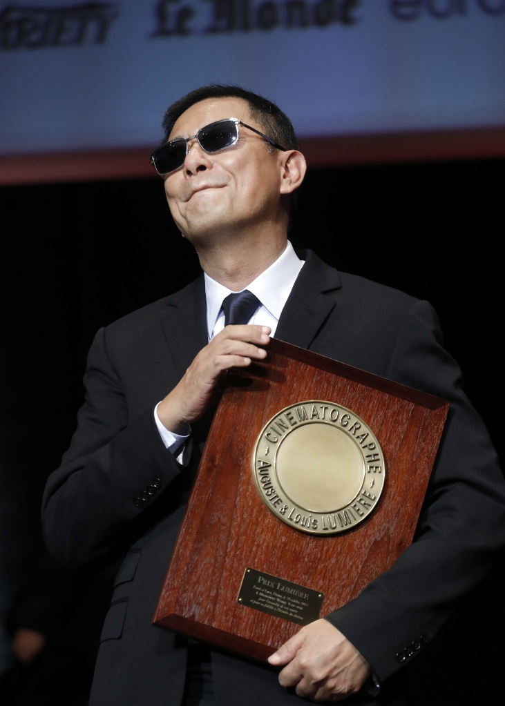 Hong Kong director Wong Kar-wai holds his trophy during the Lumiere Award ceremony of the 9th Lumiere Festival, in Lyon, central FranceLumiere Festival, Lyon, France - 20 Oct 2017