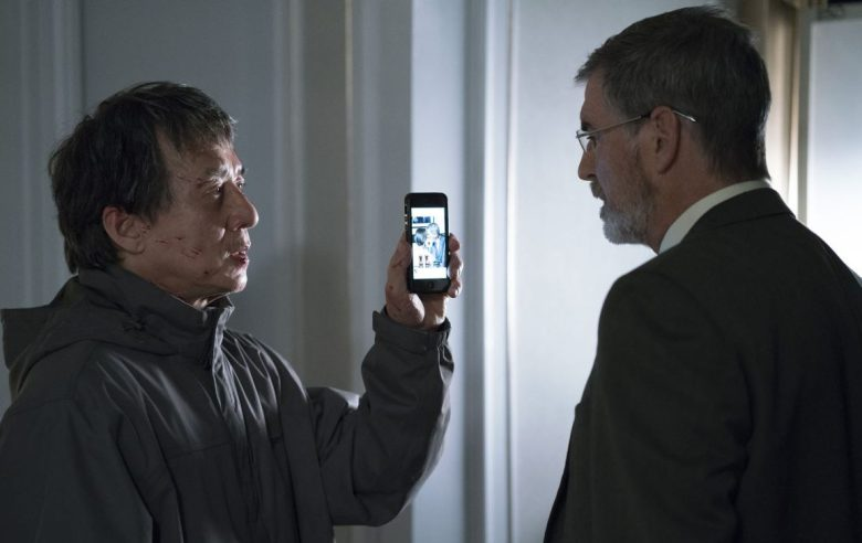 (Left to Right) Jackie Chan as Quan and Pierce Brosnan as Hennessy in hotel suite in THE FOREIGNER