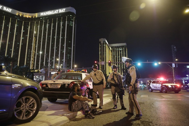 Police officers stand at the scene of a shooting near the Mandalay Bay resort and casino on the Las Vegas Strip, in Las Vegas. Multiple victims were being transported to hospitals after a shooting late Sunday at a music festival on the Las Vegas StripShooting, Las Vegas, USA - 01 Oct 2017