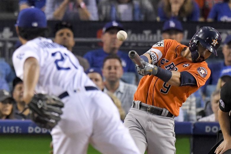 Houston Astros' Marwin Gonzalez hits a double off Los Angeles Dodgers starting pitcher Yu Darvish, of Japan, during the second inning of Game 7 of baseball's World Series, in Los AngelesWorld Series Astros Dodgers Baseball, Los Angeles, USA - 01 Nov 2017