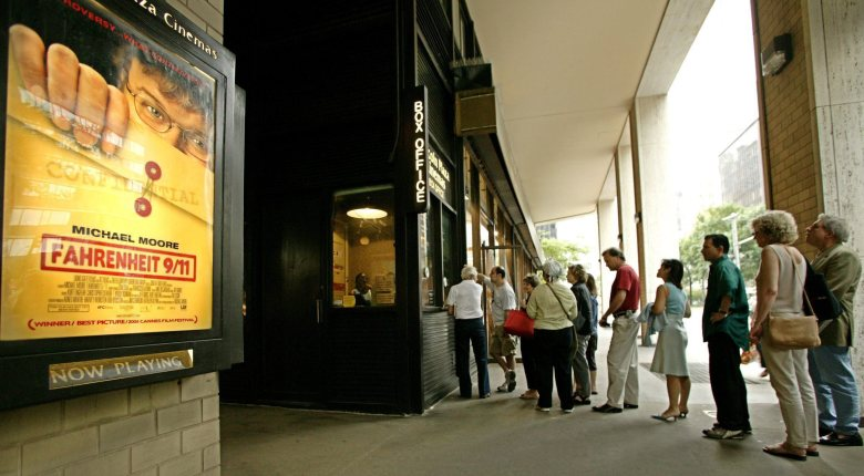 Theatre Goers Purchase Tickets to One of the Few Remaining Non Sold-out Shows of Michael Moore's New Film 'Fahrenheit 9/11' at the Lincoln Plaza Cinema in New York the Movie Opened in 868 Theaters Nationwide a Record For a Documentary Film Friday 25 June 2004Fahrenheit 9/11 Open Susa - Jun 2004