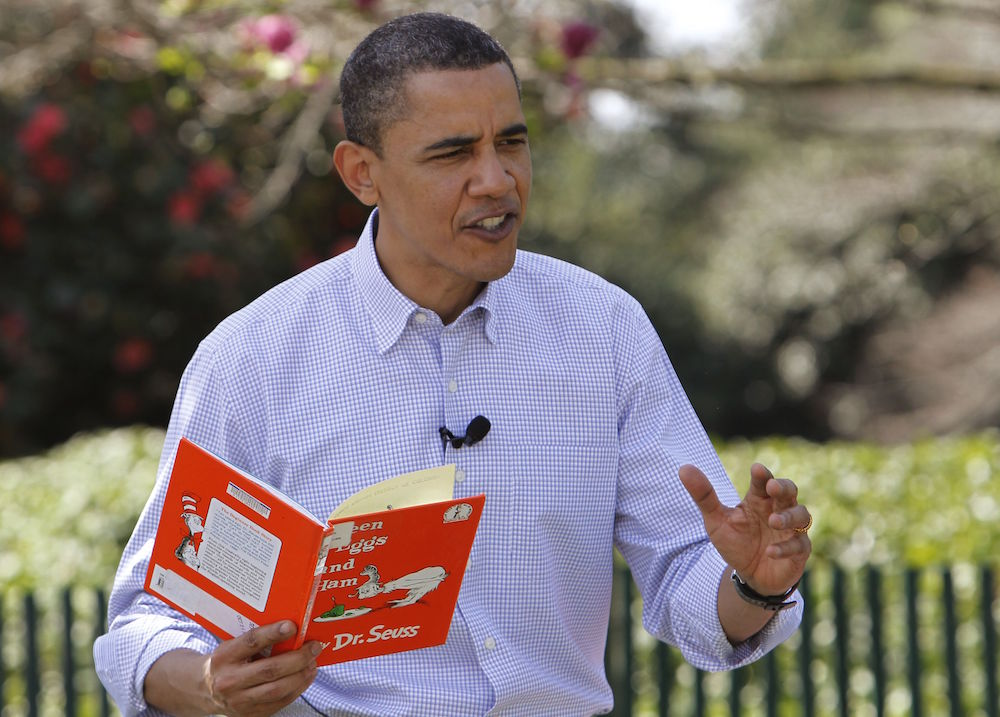 "Barack Obama President Barack Obama reads ""Green Eggs and Ham"" by Dr. Seuss as he hosts the annual White House Easter Egg Roll, on the South Lawn of the White House in WashingtonObama Easter Egg Roll, Washington, USA"