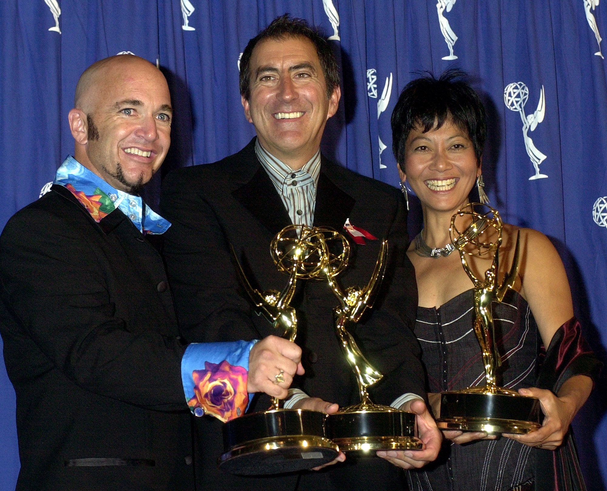 ORTEGA JACK KAWAHARA Celebrating their Emmy win in a tie for Outstanding Choreography are from left, Doug Jack, Kenny Ortega and Sarah Kawahara, for the Opening Ceremony at the 2002 Salt Lake Winter Games, at the 2002 Primetime Creative Arts Emmy Awards, at the Shrine Auditorium in Los AngelesCREATIVE ARTS EMMYS, LOS ANGELES, USA