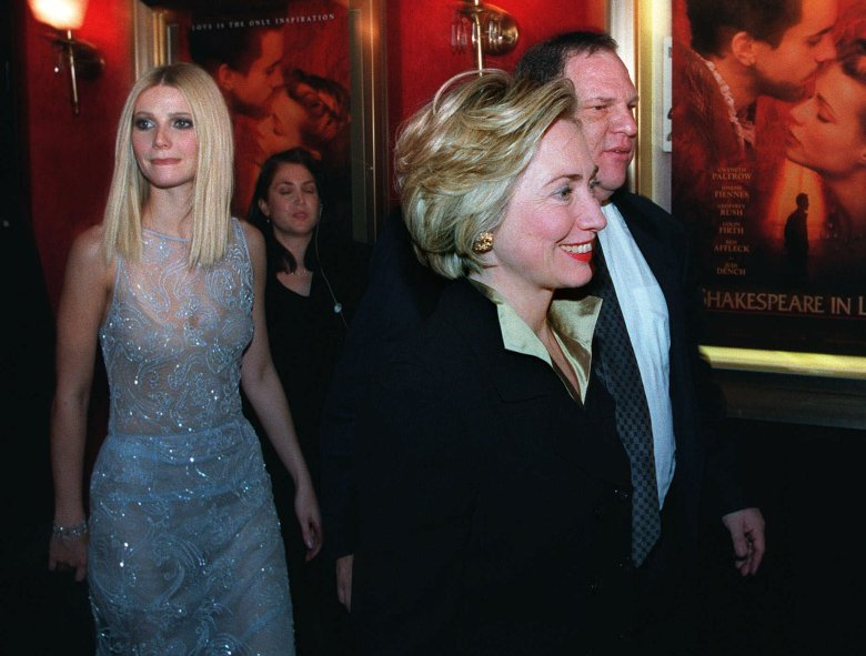 """CLINTON PALTROW WEINSTEIN First lady Hillary Rodham Clinton walks with Miramax Co-Chairman Harvey Weinstein and is followed by actress Gwyneth Paltrow into the premier of her new movie """"Shakespeare in Love,"""" in New YorkMRS CLINTON NY, NEW YORK, USA"""