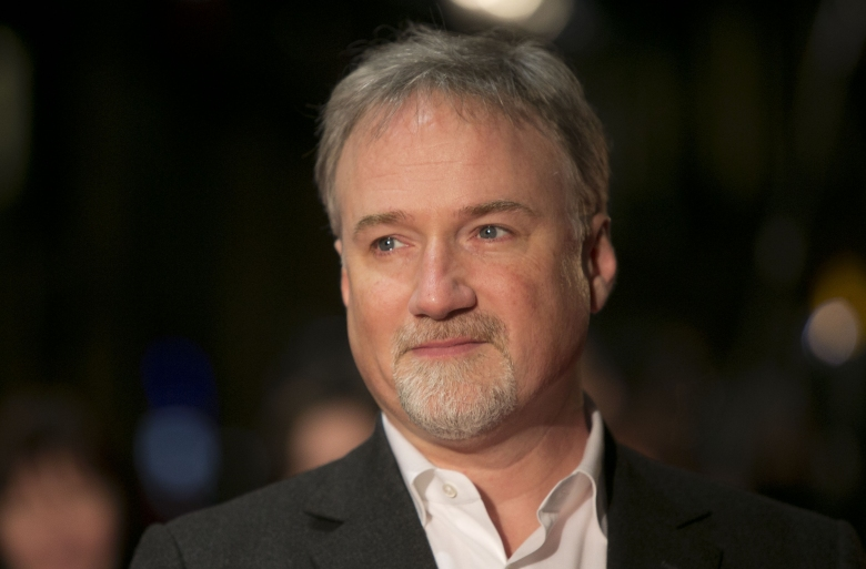 "Director David Fincher arrives on the red carpet for the Netflix UK Premiere of 'House of Cards' at a Leicester Square cinema in London. Ben Affleck and Fincher are reteaming for a remake of Alfred Hitchcock's 'Strangers on a Train.'? On the heels of their 2014 box-office hit ""Gone Girl,"" the star and the director will reunite for a film based on the 1951 classic in which two strangers meet on a train and conspire to carry out murders for one anotherFilm-Strangers on a Train Remake"