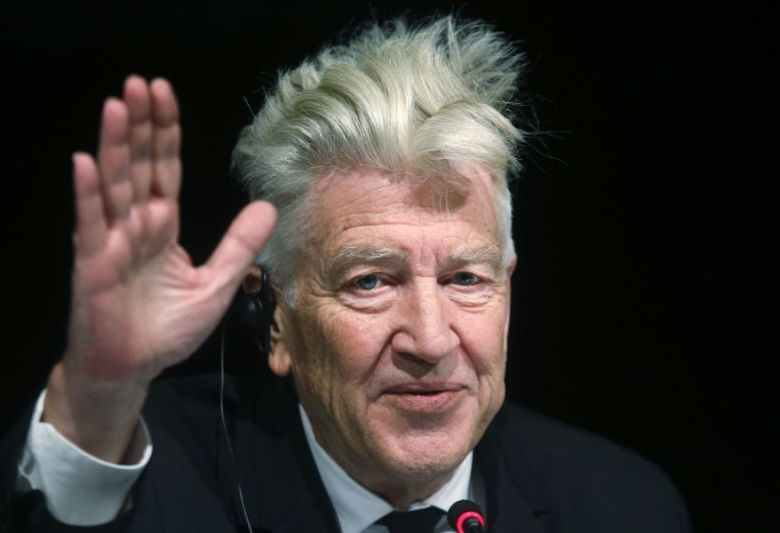 US director David Lynch gestures as