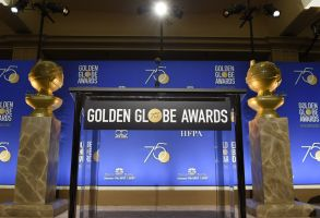 Two Golden Globes statues flank the podium prior to the nominations for 75th annual Golden Globe Awards at the Beverly Hilton hotel, in Beverly Hills, Calif. The 75th annual Golden Globe Awards will be held on Sunday, Jan. 7, 201875th Annual Golden Globe Awards - Nominations, Beverly Hills, USA - 11 Dec 2017