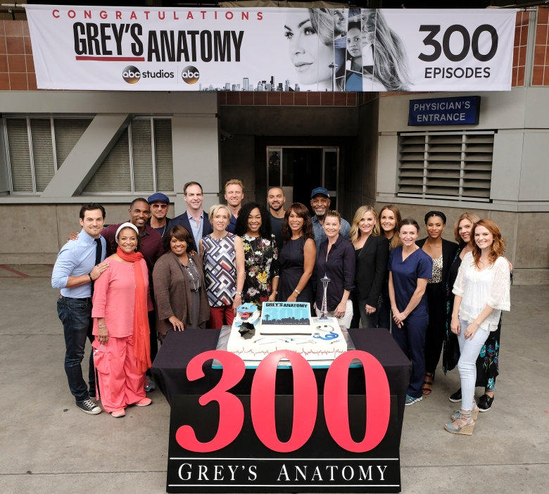 """GREY'S ANATOMY - The cast and Executive Producers of ABC's """"Grey's Anatomy"""" along with ABC Executives Channing Dungey and Patrick Moran celebrate the taping of the 300th episode on set with a cake-cutting ceremony in Los Angeles on Tuesday, September 26. The episode will air later this season. (ABC/Eddy Chen)GIACOMO GIANNIOTTI, DEBBIE ALLEN (EXECUTIVE PRODUCER), JASON GEORGE, JUSTIN CHAMBERS, CHANDRA WILSON, PATRICK MORAN (PRESIDENT, ABC STUDIOS), BETSY BEERS (EXECUTIVE PRODUCER), KEVIN MCKIDD, SHONDA RHIMES (CREATOR/EXECUTIVE PRODUCER), JESSE WILLIAMS, CHANNING DUNGEY (PRESIDENT, ABC ENTERTAINMENT), JAMES PICKENS JR., ELLEN POMPEO, JESSICA CAPSHAW, CAMILLA LUDDINGTON, CATERINA SCORSONE, KELLY MCCREARY, SARAH DREW"""