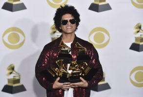 """Bruno Mars poses in the press room with his awards for best R&B album, record of the year, album of the year, best engineered album, non-classical, for """"24K Magic,"""" and song of the year, best R&B performance and best R&B song, for """"That's What I Like"""" at the 60th annual Grammy Awards at Madison Square Garden, in New York60th Annual Grammy Awards - Press Room, New York, USA - 28 Jan 2018"""