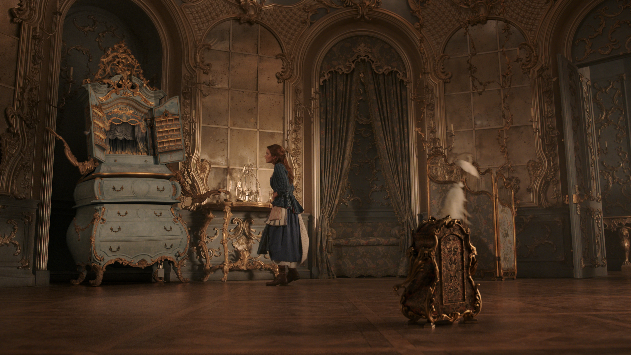 Belle (Emma Watson) learns that the Beast's castle is enchanted in Disney's BEAUTY AND THE BEAST, directed by Bill Condon.