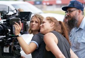 "Director Augustine Frizzell on the set of ""Never Goin' Back"""