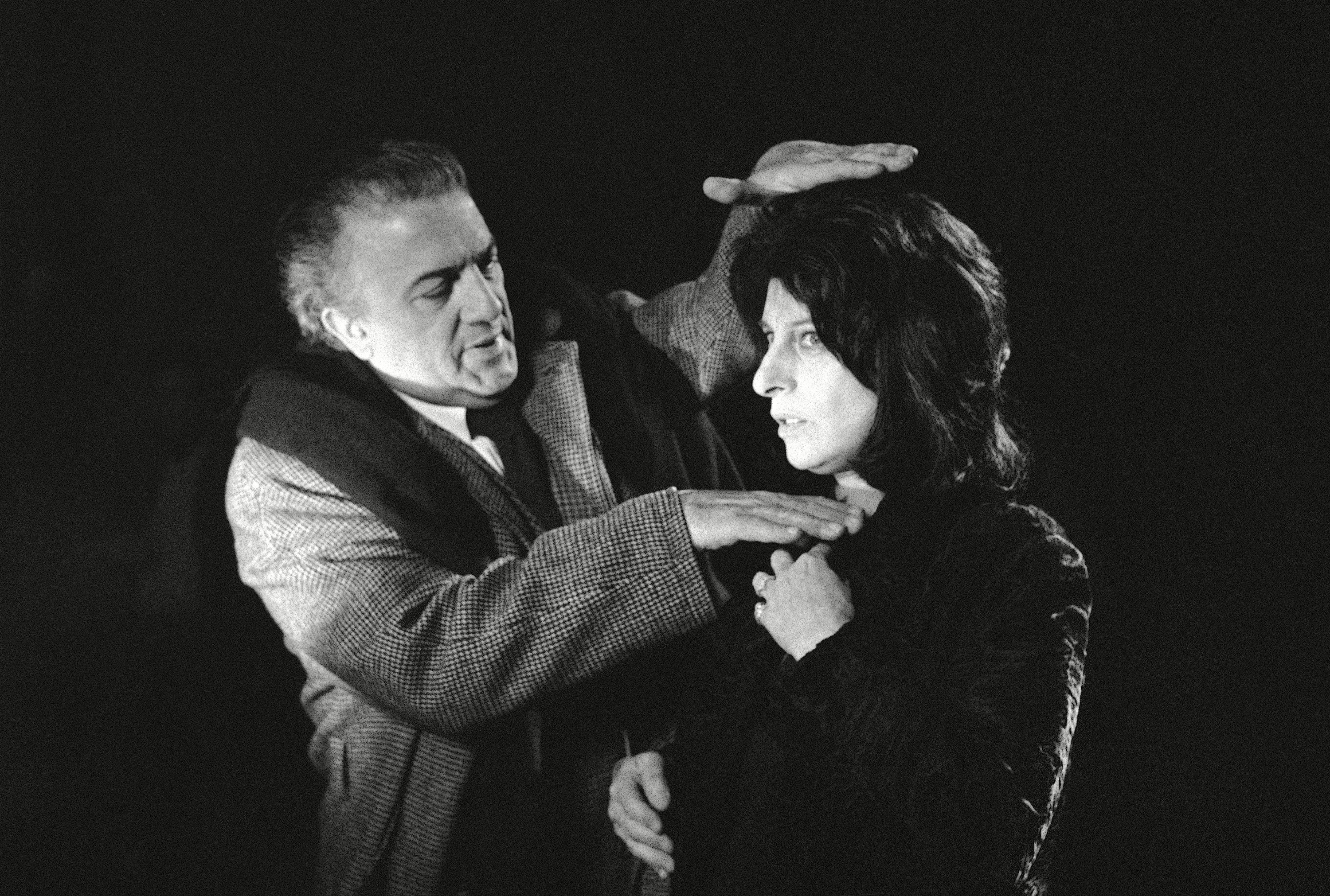 "Italian film director Federico Fellini studies the framing of a close-up of Italian movie and stage star Anna Magnani in Rome, Italy on . He is seen on the set of the movie ""Roma"" which he is directingItaly Rome Federico Fellini and Anna Magnani, Rome, Italy"
