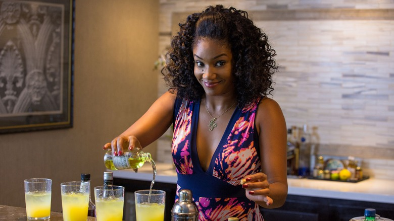 """TIFFANY HADDISH as Dina in """"Girls Trip."""" When four lifelong friends—Sasha (QUEEN LATIFAH), Ryan (REGINA HALL), Lisa (JADA PINKETT SMITH) and Dina—travel to New Orleans for the annual """"Essence"""" Festival, sisterhoods are rekindled, wild sides are rediscovered, and there's enough dancing, drinking, brawling and romancing to make the Big Easy blush."""