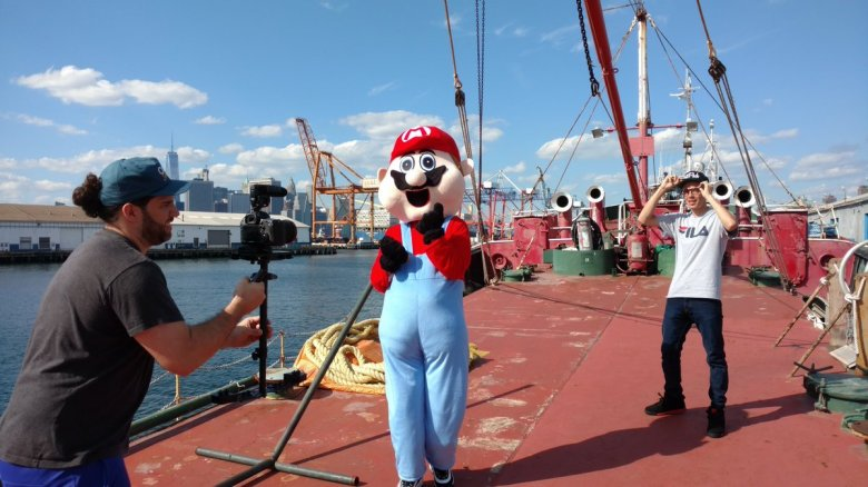 "Justin Fleischer and Logic shooting ""Super Mario World"" aboard the Mary A. Whalen"