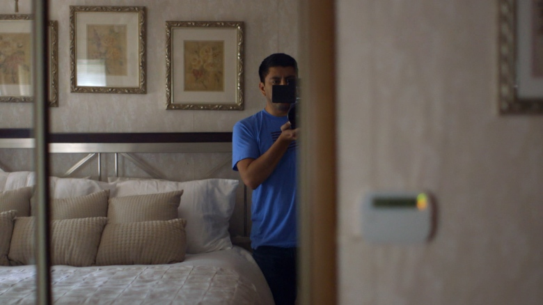 "Rudy Valdez catches himself in the mirror while shooting ""The Sentence"""