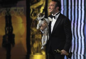 """Jean Dujardin, Uggie Jean Dujardin holds Uggie after accepting the Oscar for best picture for """"The Artist"""" during the 84th Academy Awards, in the Hollywood section of Los Angeles84th Academy Awards Show, Los Angeles, USA"""