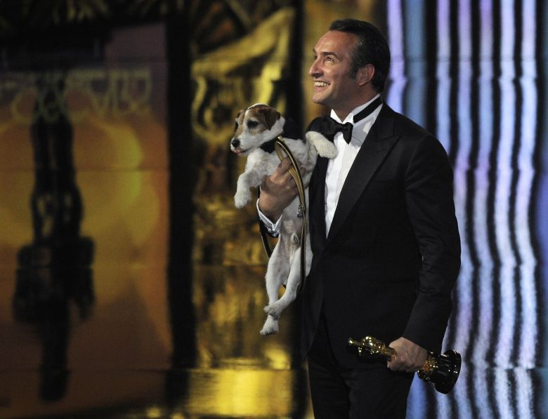 "Jean Dujardin, Uggie Jean Dujardin holds Uggie after accepting the Oscar for best picture for ""The Artist"" during the 84th Academy Awards, in the Hollywood section of Los Angeles84th Academy Awards Show, Los Angeles, USA"