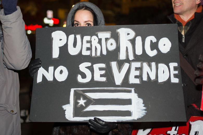 Demonstrators gather in Union Square, New York City 100 days after Hurricane Maria made landfall in Puerto Rico. It is estimated that more than 50% of the island is still without power. Hurricane Maria killed 64 Puerto Ricans. Approximately 1,000 more died as a result of poor disaster response. Protest over handling of Puerto Rico hurricane relief aid, New York, USA - 29 Dec 2017