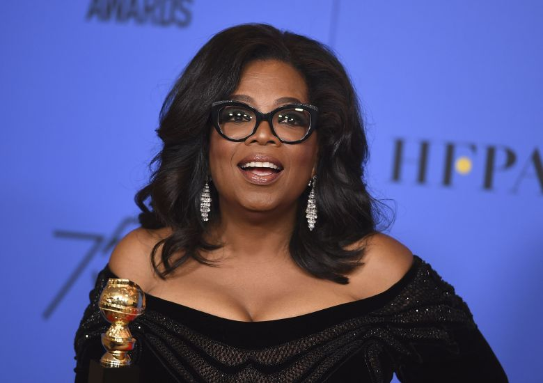 Oprah Winfrey poses in the press room with the Cecil B. DeMille Award at the 75th annual Golden Globe Awards at the Beverly Hilton Hotel, in Beverly Hills, Calif75th Annual Golden Globe Awards - Press Room, Beverly Hills, USA - 07 Jan 2018