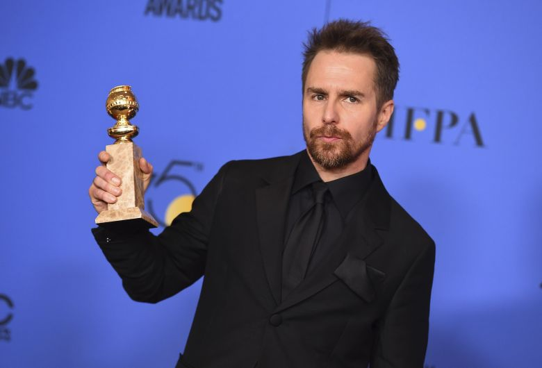 """Sam Rockwell poses in the press room with the award for best performance by an actor in a supporting role in any motion picture for """"Three Billboards Outside Ebbing, Missouri"""" at the 75th annual Golden Globe Awards at the Beverly Hilton Hotel, in Beverly Hills, Calif75th Annual Golden Globe Awards - Press Room, Beverly Hills, USA - 07 Jan 2018"""