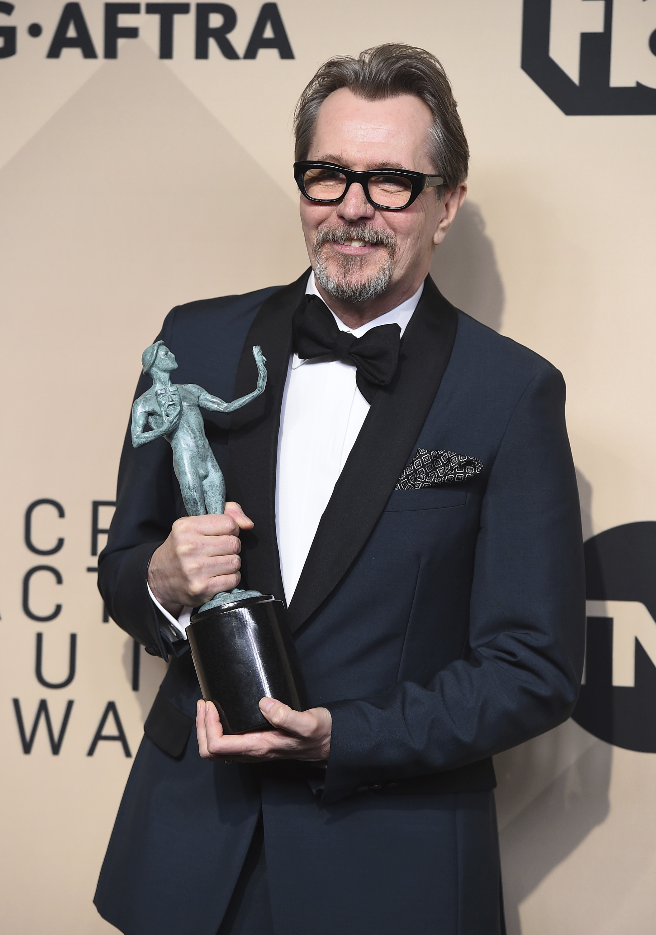 "Gary Oldman, winner of the award for outstanding performance by a male actor in a leading role for ""Darkest Hour"", poses in the press room at the 24th annual Screen Actors Guild Awards at the Shrine Auditorium & Expo Hall, in Los Angeles 24th Annual SAG Awards - Press Room, Los Angeles, USA - 21 Jan 2018"