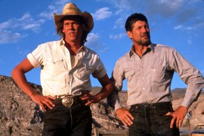 No Merchandising. Editorial Use OnlyMandatory Credit: Photo by SNAP/REX/Shutterstock (390847jm)FILM STILLS OF 'TREMORS' WITH 1990, KEVIN BACON, CLOTHING, COWBOY, DESERT, HAT, JEANS, FRED WARD IN 1990VARIOUS