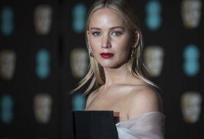 Jennifer Lawrence poses for photographers upon arrival at the BAFTA Film Awards, in LondonBritain BAFTA Awards 2018 Arrivals - 18 Feb 2018