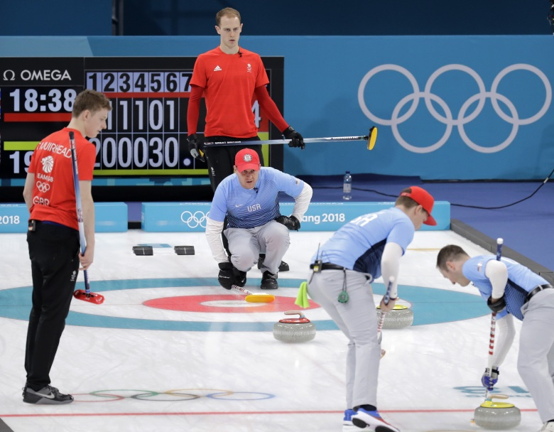 Britain's skip Kyle Smith, second from left, stands behind United States's skip John Shuster during their men's curling match at the 2018 Winter Olympics in Gangneung, South KoreaPyeongchang Olympics Curling Men, Gangneung, South Korea - 21 Feb 2018