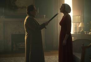 "The Handmaid's Tale  -- ""Late"" Episode 103 -- Offred visits Janine's baby with Serena Joy and remembers the early days of the revolution before Gilead. Ofglen faces a difficult challenge. Aunt Lydia (Ann Dowd) and Offred (Elisabeth Moss), shown.  (Photo by: George Kraychyk/Hulu)"