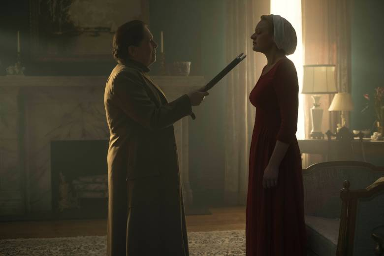 """The Handmaid's Tale  -- """"Late"""" Episode 103 -- Offred visits Janine's baby with Serena Joy and remembers the early days of the revolution before Gilead. Ofglen faces a difficult challenge. Aunt Lydia (Ann Dowd) and Offred (Elisabeth Moss), shown.  (Photo by: George Kraychyk/Hulu)"""