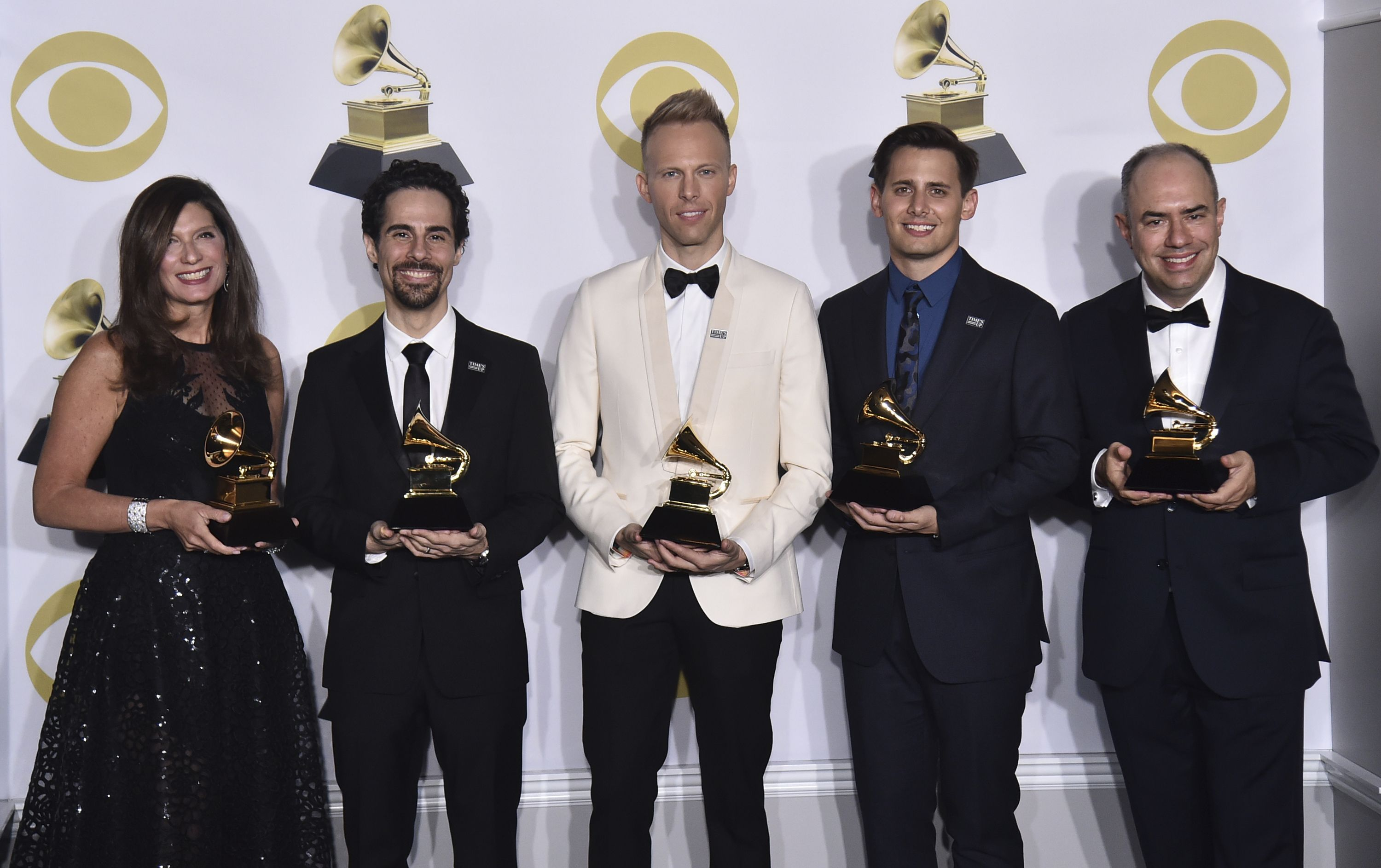 "Stacey Mindich, Alex Lacamoire, Justin Paul, Benj Pasek, Pete Ganbarg. Stacey Mindich, from left, Alex Lacamoire, Justin Paul, Benj Pasek, Pete Ganbarg pose in the press room with the best musical theater album award for ""Dear Evan Hansen"" at the 60th annual Grammy Awards at Madison Square Garden, in New York60th Annual Grammy Awards - Press Room, New York, USA - 28 Jan 2018"