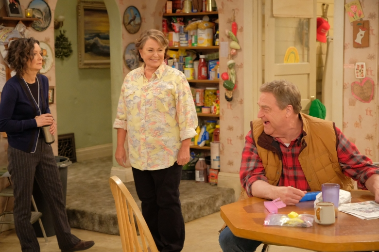 "ROSEANNE - ""Twenty Years to Life"" - Roseanne and Dan adjust to living under the same roof with Darlene and her two children, Harris and Mark, when Darlene loses her job. Meanwhile, Becky announces she is going to be a surrogate to make extra money; and Roseanne and Jackie are at odds with one another, on the season premiere and first episode of the revival of ""Roseanne,"" TUESDAY, MARCH 27 (8:00-8:30 p.m. EDT), on The ABC Television Network. (ABC/Adam Rose)SARA GILBERT, ROSEANE BARR, JOHN GOODMAN"