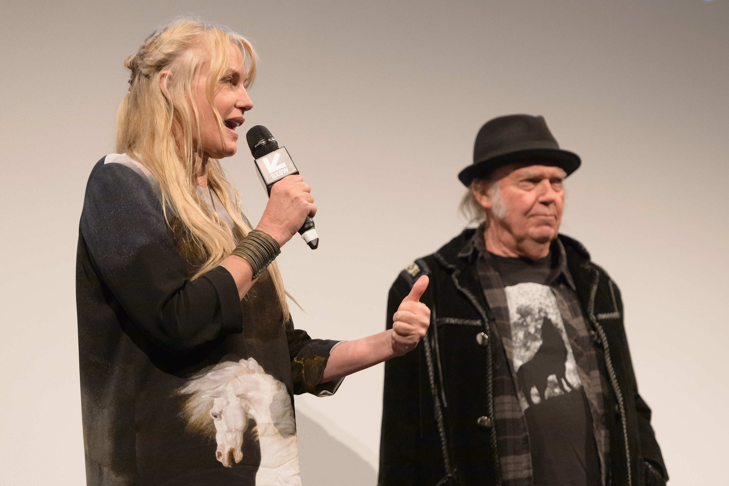 "AUSTIN, TX - MARCH 15: Director Daryl Hannah and Neil Young attend the ""Paradox"" red carpet premiere at Paramount Theatre during SXSW 2018 on March 15, 2018 in Austin, Texas. (Photo by Daniel Boczarski/Getty Images for Netflix) *** Local Caption *** Daryl Hannah;Neil Young"