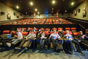 People in a Vue Cinema on the reclining electric seats.Reclining electric seats at Vue Cinema, UK - Dec 2015